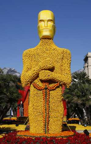A sculpture featuring an Oscar statue made from lemons and oranges is seen during the 77th lemon festival in Menton